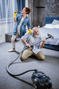 Couple with vacuum cleaner