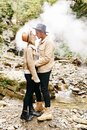 Couple in vape cloud. Two in smoke. Tourists in cold autumn forest with vape. Man and women in smoke. Two smokers. Beautiful Royalty Free Stock Photo