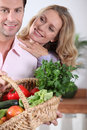 Couple with vegetable basket Stock Images