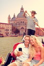 Couple in venice on gondola ride on canal grande doing taking selfie self portrait using smartphone camera happy young romantic Stock Images