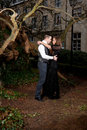 Couple in Victorian clothing embracing in the park Royalty Free Stock Photo