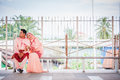 Couple waiting for train at station newly wedded posing railway Royalty Free Stock Photos