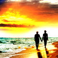 Couple Walk on the Beach Stock Photography