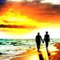 Couple Walk on the Beach Royalty Free Stock Photo
