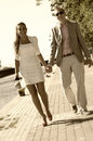 Couple on walk a a outdoors holding hands Stock Photo