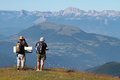 Couple of walkers admire the landscape chamrousse france july from top chamrousse resort called la croix de chamrousse Royalty Free Stock Image