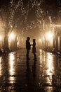 Couple walking at alley in night lights. Royalty Free Stock Photography
