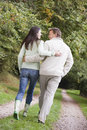 Couple walking along woodland path Royalty Free Stock Photos
