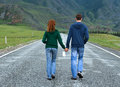 Couple walking altai road young happy caucasian men and woman along the asphalt among beautiful mountain area territory russia Royalty Free Stock Images