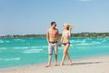 Couple walking on the beach picture of happy Royalty Free Stock Photo