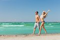 Couple walking on the beach picture of happy Stock Image