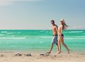 Couple walking on the beach picture of happy Royalty Free Stock Images