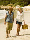 Couple walking on the beach sandy Stock Photography