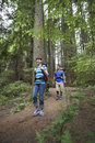 Couple walking in forest full length low angle view of a Royalty Free Stock Photography