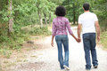 Couple walking in a forest hand hand Stock Photo