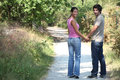 Couple walking hand in hand Royalty Free Stock Image