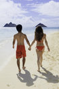 Couple walking on a hawaii beach Stock Images