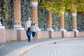 Couple walking in Mikhailovsky garden of Saint-Petersburg Royalty Free Stock Image