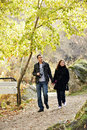 Couple walking newly engaged in their twenties holding hands and in winter Royalty Free Stock Image