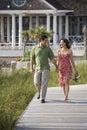 Couple walking outdoors. Royalty Free Stock Photo