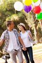 Couple walking park cute teen at the holding hands Royalty Free Stock Image