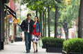 Couple walking on sidewalk full length of a smiling Royalty Free Stock Photos