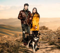 Couple walking their dog Royalty Free Stock Photo