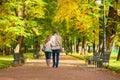 Couple Walking Together In Par...