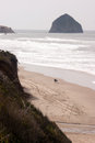Couple Walks Blustery Day Bluffs Seaside Oregon Coast Pacific Royalty Free Stock Photo