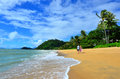 Couple walks on Trinity beach near Cairns Queensland Australia Royalty Free Stock Photo