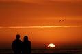 Couple watching sunset Royalty Free Stock Photo