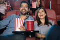 Couple watching comedy at the theater Royalty Free Stock Photo