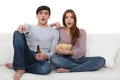 Couple watching a horror movie. Stock Photos