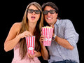 Couple watching a scary d movie and wearing glasses Royalty Free Stock Photo