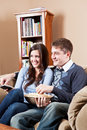Couple watching television Stock Photos