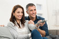 Couple watching television happy smiling at home Royalty Free Stock Images