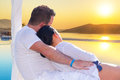 Couple watching together sunrise in greece Stock Photos