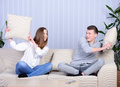 Couple watching tv relaxed young at home in bright living room Stock Image