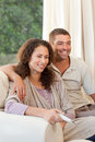 Couple watching tv in their living room Royalty Free Stock Photography