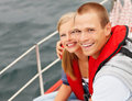 Couple wearing life jacket during their sea voyage Stock Photos