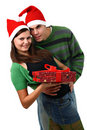 Couple wearing Santa hats with Christmas present Stock Photos