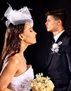 Couple wearing wedding dress and costume bride groom Stock Images