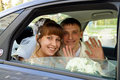 The couple in a wedding car Stock Images