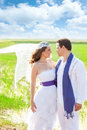 Couple in wedding day with wind on veil Royalty Free Stock Image