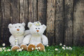 Couple: Wedding greeting card with two teddy bears on wooden bac