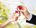 Couple with wedding ring and gift box hands Royalty Free Stock Image