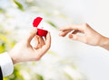 Couple with wedding ring and gift box hands Stock Image