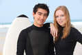 Couple in wetsuits Stock Photography