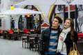 Couple in winter jackets looking away young at outdoor restaurant Royalty Free Stock Image