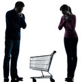 Couple woman man sad with empty shopping cart silhouette one caucasian women men in studio isolated on white background Stock Photography